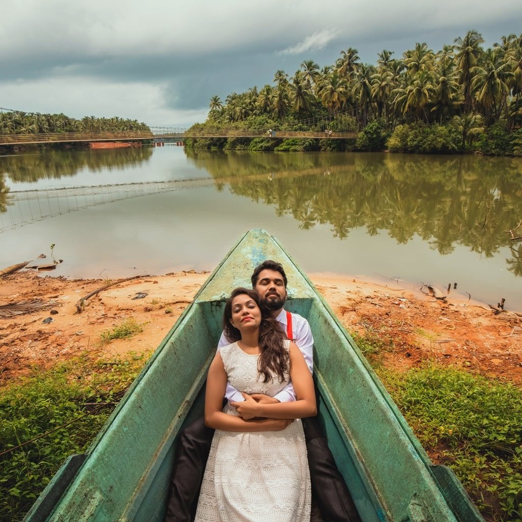 candid pre wedding picture of bride sleeping on groom in a boat