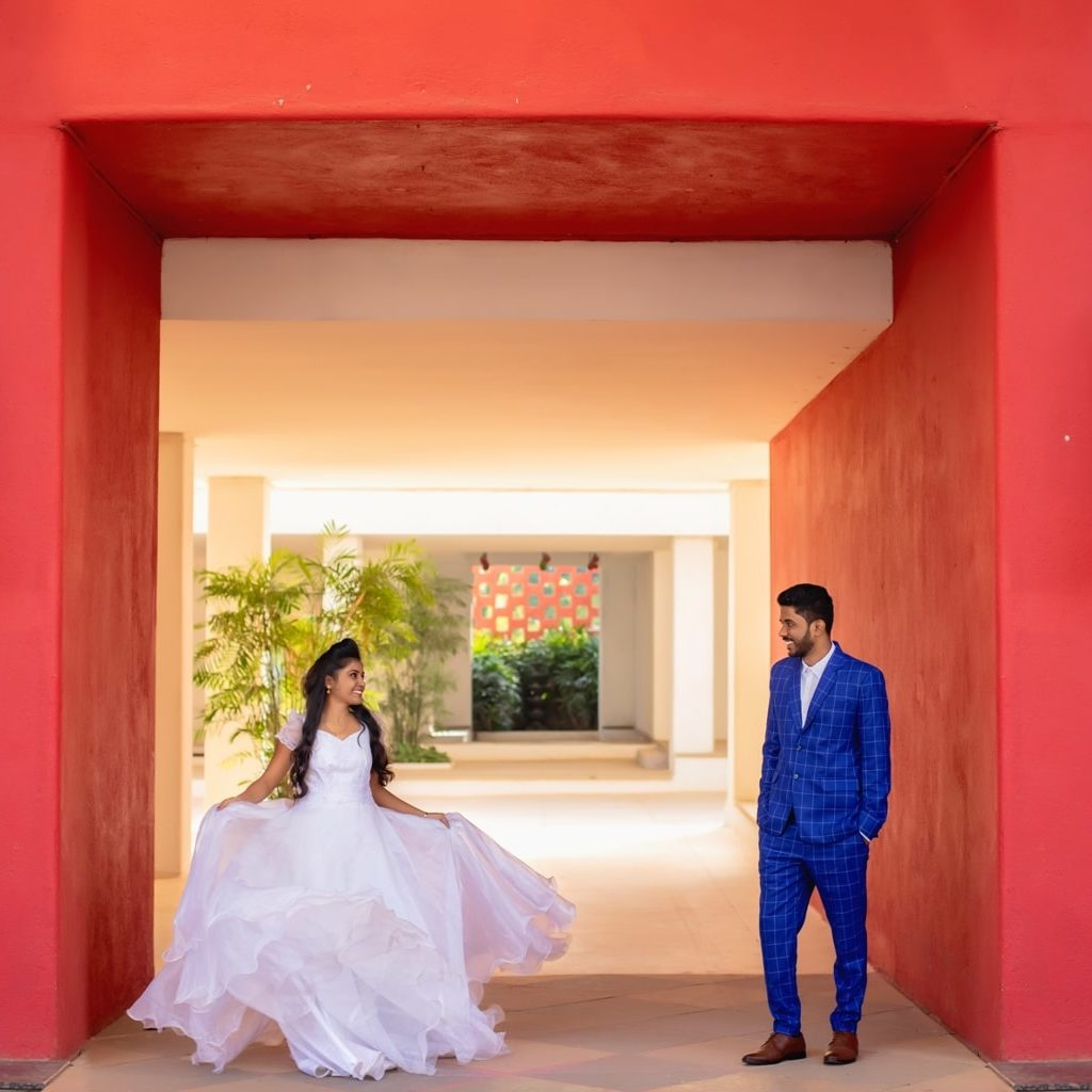 candid pre wedding picture of bride and groom looking at each other