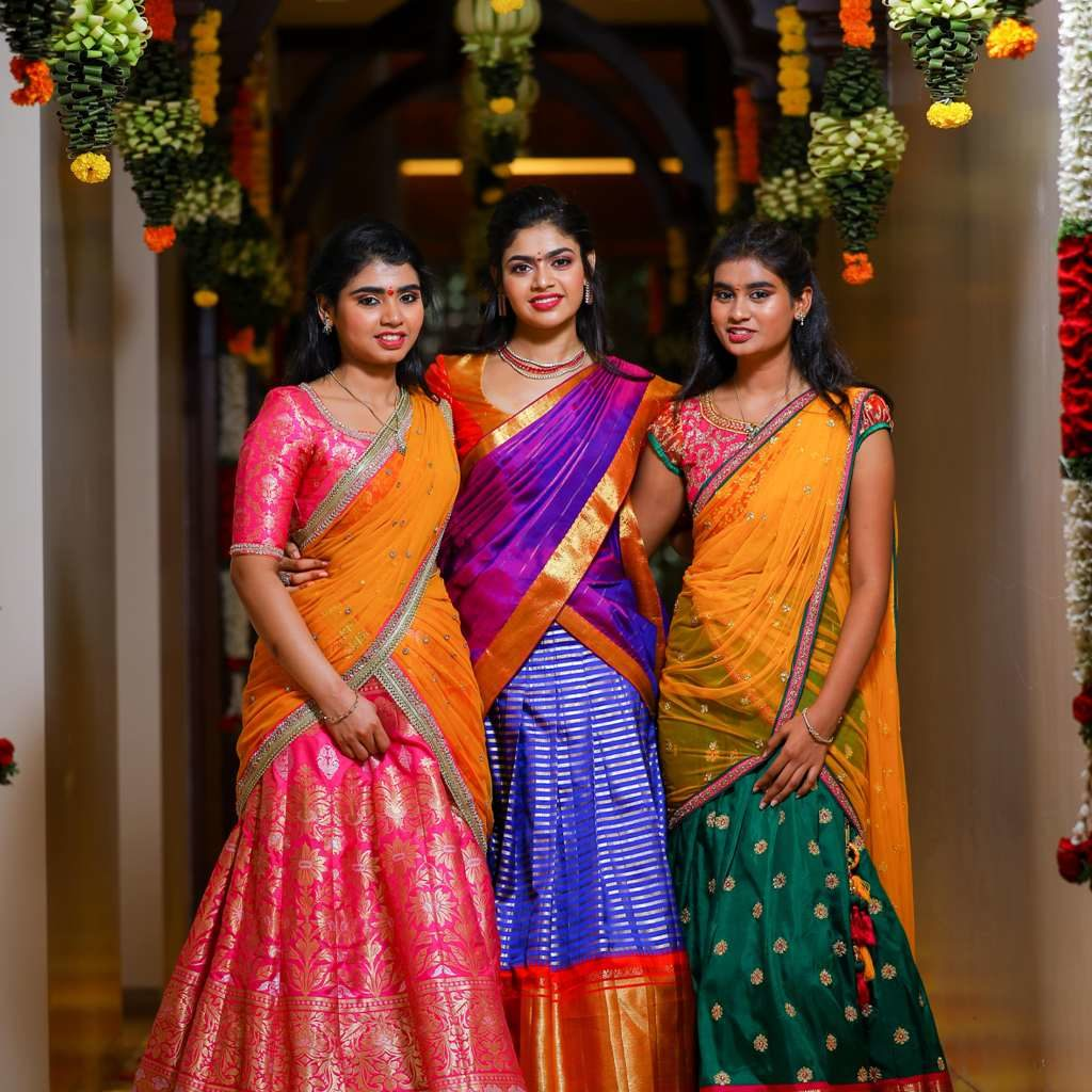 picture of bride with her sisters wearing saree in a decorated hallway