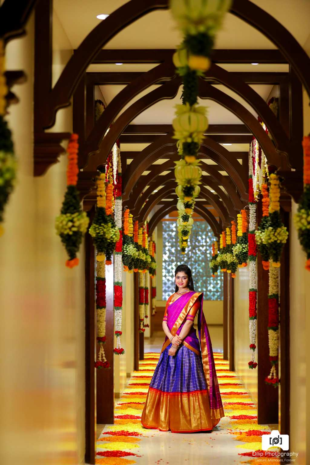 picture of sriramulu's daughter in a hallway with flower decorations