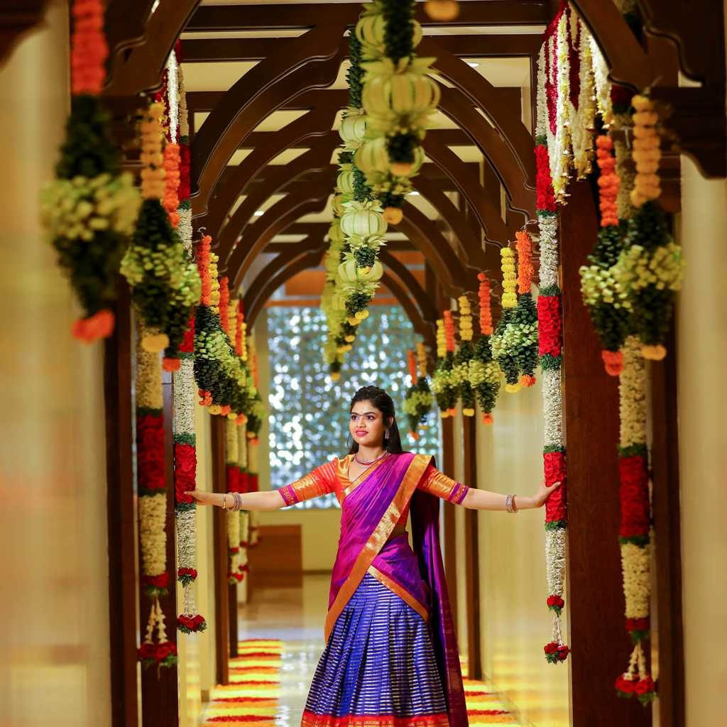 candid picture of sriramulu's daughter posing holding flower decoration garlands