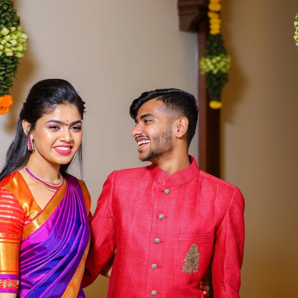 candid picture of sriramulu's daughter and son looking at each other and smiling