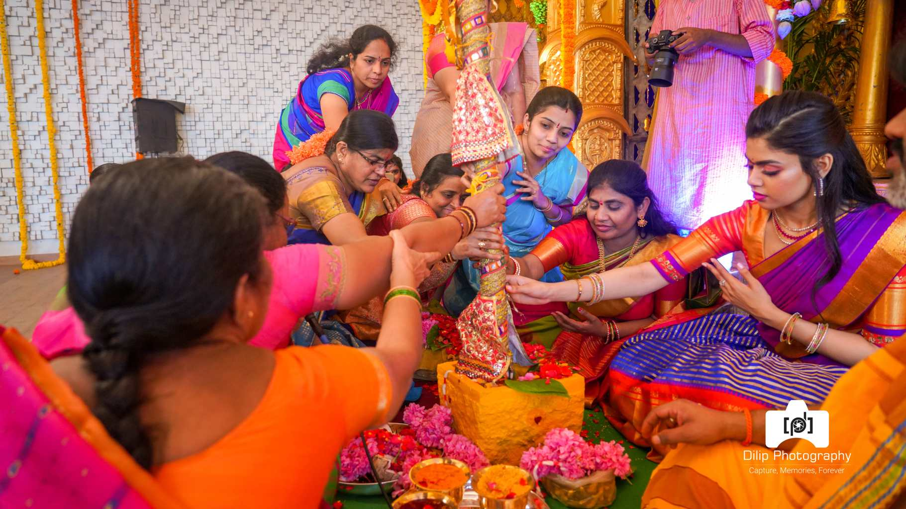candid picture of ladies performing marriage ceremony rituals