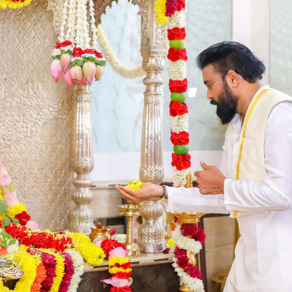 candid picture of sriramulu offering flowers to god during daughter's wedding