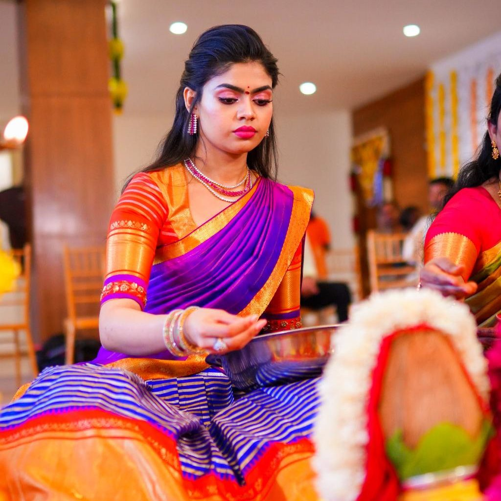 candid picture of sriramulu's daughter bride offering prayers to god